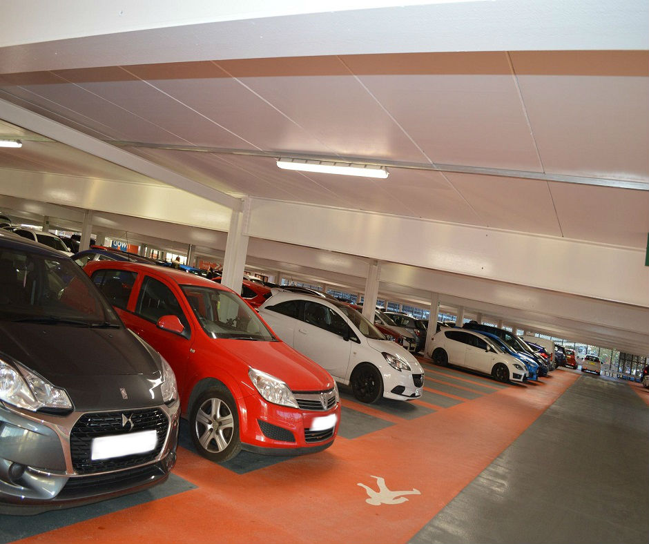 A photograph of cars parked in a row at Lincoln Central Car Park