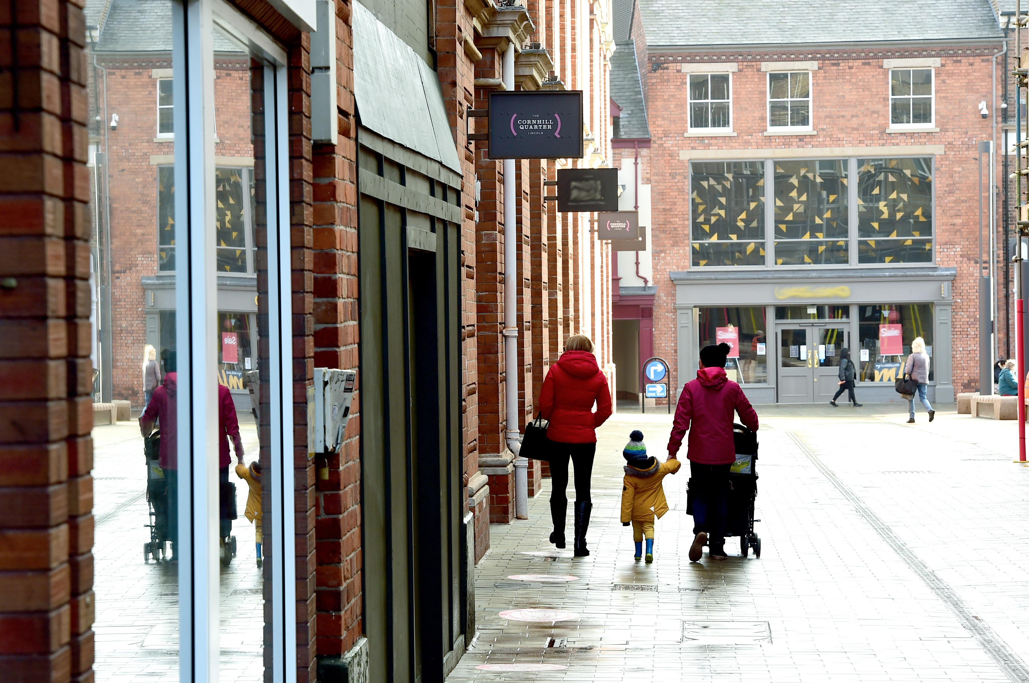 A photograph of passers by at Lincolns Cornhill quarter