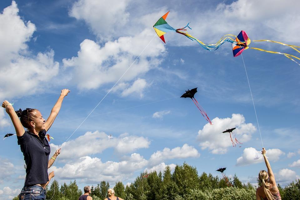 Children flying kites in a park